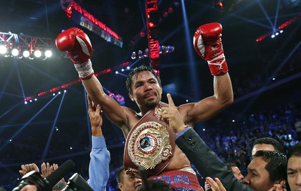 Manny Pacquiao celebrates his victory over Brandon Rios in a WBO welterweight title fight in Macau, China, on Sunday. Pacquiao's next fight could take place in Las Vegas in April.