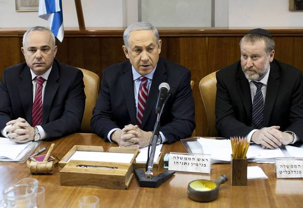 Israeli Prime Minister Benjamin Netanyahu, center, in Jerusalem, has denounced the preliminary international deal on Iran's nuclear program. Some members of the U.S. Congress may be torn between a desire to back President Obama and long-standing support for Israel.