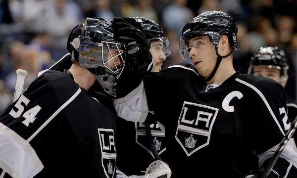 Kings goalie Ben Scrivens is congratulated by team captain Dustin Brown following a win over the Tampa Bay Lightning on Tuesday. Scrivens has performed well since taking over for injured starting goalie Jonathan Quick.