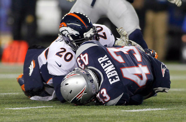 The Patriots' Nate Ebner recovers the ball after it bounced off the Broncos' Mike Adams on a punt in overtime, setting up the winning field goal.