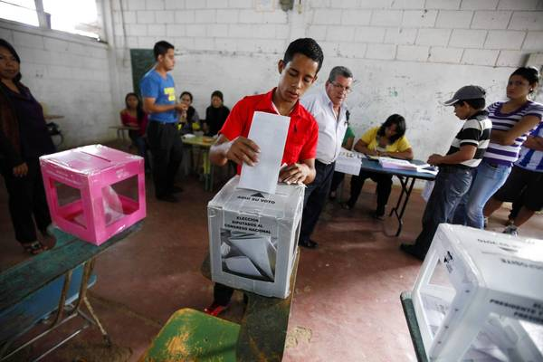 A Honduran man casts his vote for president at a polling station in Catacamas.