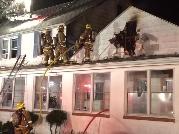 Firefighters battle an early morning fire in Ellicott City.