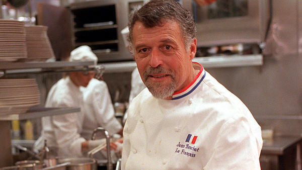 Le Francais chef Jean Banchet stands in the restaurant kitchen.