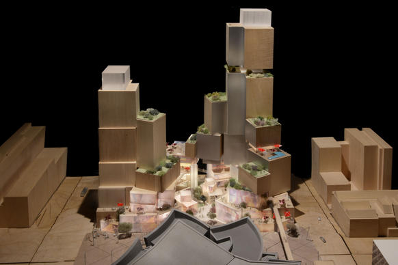 A proposal by architect Frank Gehry's firm calls for a stacked collection of shops and restaurants and includes two towers, one holding an SLS Hotel and the other filled with condominiums and apartments.