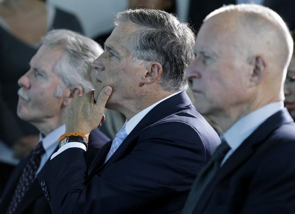 Oregon Gov. John Kitzhaber, left, Washington Gov. Jay Inslee and California Gov. Jerry Brown listen to a speaker on Oct. 28 in San Francisco before signing an agreement to collectively combat climate change. Kitzhaber was honored as one of Governing Magazine's public officials of the year.