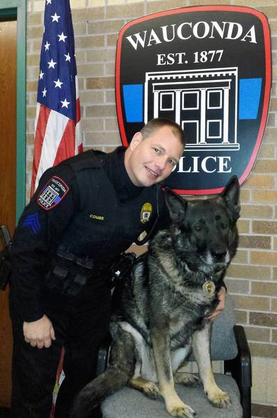 Wauconda police Sgt. John Combs poses with his dog, Maxx. A nine-year veteran, Maxx is set to retire in May.