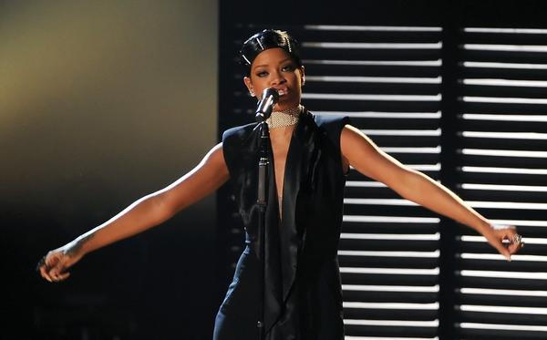 Rihanna performs onstage during the 2013 American Music Awards at Nokia Theatre L.A. Live on Nov. 24, 2013, in Los Angeles.