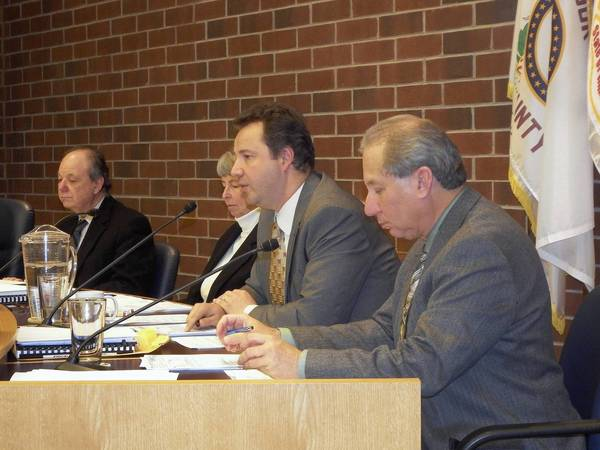 Niles Trustee Chris Hanusiak, second from right, addresses fellow trustees during the Nov. 19 Niles Village Board meeting.
