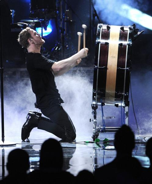 Singer Dan Reynolds of Imagine Dragons performs during the 2013 American Music Awards at Nokia Theatre L.A. Live on Nov. 24, 2013, in Los Angeles,