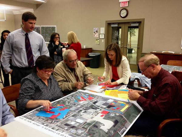 Ellen Johnson (center) of the Kane County Planning Cooperative works with St. Charles residents to map out potential development on parcels along Randall Road.