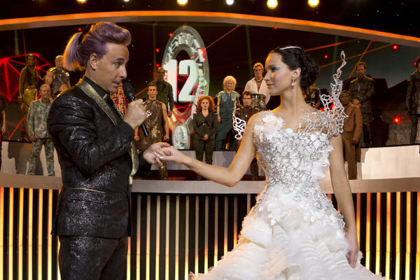 "Stanley Tucci as Caesar Flickerman and Jennifer Lawrence as Katniss Everdeen in ""The Hunger Games: Catching Fire."""