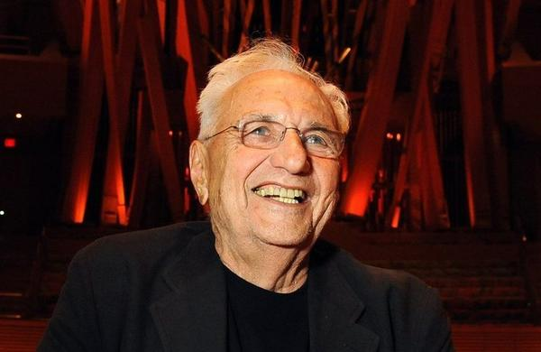 Architect Frank Gehry stands inside the Disney Hall he designed, which celebrated its 10th anniversary.