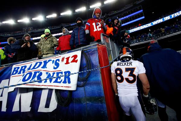 Denver receiver Wes Welker, a former New England player, leaves the field after the Broncos' 34-31 overtime loss to the Patriots at Gillette Stadium on Sunday night.