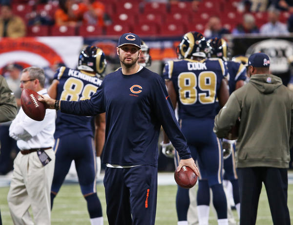 Injured Chicago Bears quarterback Jay Cutler retrieves balls before the game Sunday.