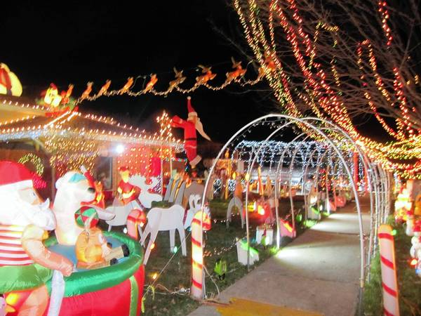 Dominic Kowalczyk's front lawn in Tinley Park includes more than 200 decorations. Kowalczyk is scheduled to compete on an ABC reality show airing Dec. 23.