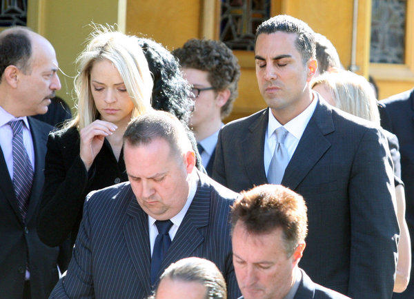 Assemblyman Mike Gatto, with his wife Danielle, mourn as they follow the casket of Mike Gatto's father Joseph Anthony Gatto at funeral services at Our Mother of Good Counsel Church in Los Angeles on Monday, November 25, 2013. Joe Gatto was killed in his home during an apparent home invasion robbery. (Tim Berger/Staff Photographer)