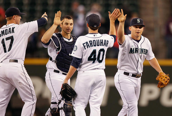 Members of the Seattle Mariners celebrate after defeating the Oakland Athletics at Safeco Field on Sept. 28 in Seattle.