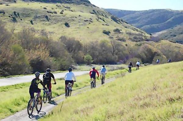 Cyclists travel through Aliso and Wood Creeks Park.