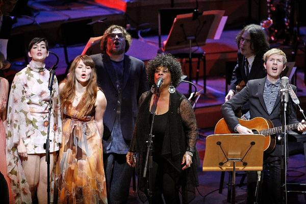 "Beck, far right, performs with special guests including Anne Hathaway, left, Jenny Lewis, Jack Black, Merry Clayton and Jon Brion during his ""Song Reader"" project at Disney Hall in downtown Los Angeles on Sunday."