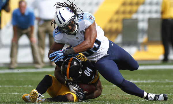 Michael Griffin of the Tennessee Titans hits Antonio Brown of the Pittsburgh Steelers in the second half during the game on Sept. 8 in Pittsburgh.