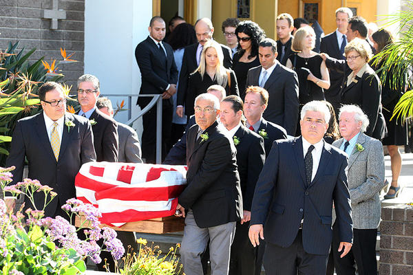 The casket of Joseph Anthony Gatto is carried by pallbearers at the funeral for the slain father of Congressman Mike Gatto Our Mother of Good Counsel Church. Inside the casket was covered with white cloth. Once outside, it was draped with an American flag.