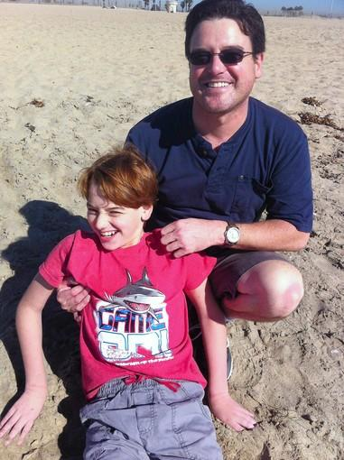 Dario Covey and his 12-year-old son, Anthony, enjoy a day at Huntington Beach.