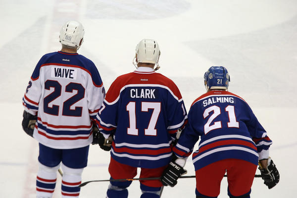 Former Toronto Maple Leafs players Rick Vaive, Wendel Clark, Borje Salming wait for a faceoff during the 2013 Hockey Hall of Fame Legends Classic game at the Mattamy Athletic Center on Nov. 10 in Toronto.
