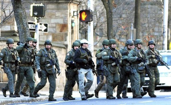 Police respond to reports of a gunman on the Yale University campus in New Haven, Conn. No gunman was found.