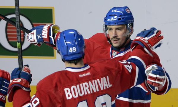 Montreal Canadiens center Tomas Plekanec, right, celebrates with teammate Michael Bournival after scoring a goal against the Ducks last month. Plekanec has done his part in the Canadiens' current 5-1-1 run.