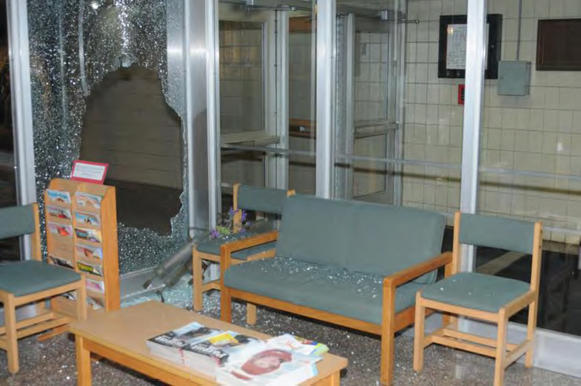 A police photo shows damage inside the front entrance at Sandy Hook Elementary School after the Dec. 14 massacre in Newtown, Conn. A report released Monday by State Atty. Stephen Sedensky III found gunman Adam Lanza to be criminally responsible for the shootings, despite his mental health problems