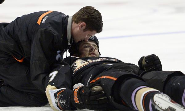 Dustin Penner is attended to by a trainer after being knocked briefly unconscious on a hit by Dallas Star forward Ryan Garbutt last month. Garbutt was suspended five games by the NHL for the hit.