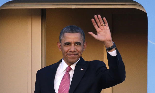 President Obama waves on his arrival at Seattle-Tacoma International Airport.