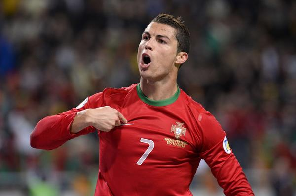 TOPSHOTS Portugal's forward Cristiano Ronaldo celebrates after scoring the second goal for Portugal during the FIFA 2014 World Cup playoff football match Sweden vs Portugal at the Friends Arena in Solna near Stockholm on November 19, 2013 .