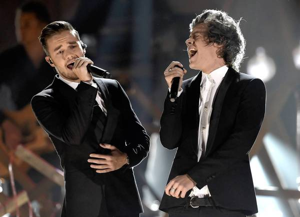 Singers Liam Payne, left, and Harry Styles of One Direction perform ontage during the 2013 American Music Awards.