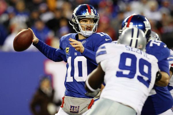 Giants quarterback Eli Manning (10) drops back to pass during the loss to the Cowboys at MetLife Stadium on Sunday.