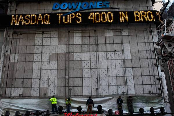 A news ticker in New York's Times Square announces the Nasdaq composite index topping 4,000 points during intraday trading. The Nasdaq hasn't topped 4,000 since 2000.