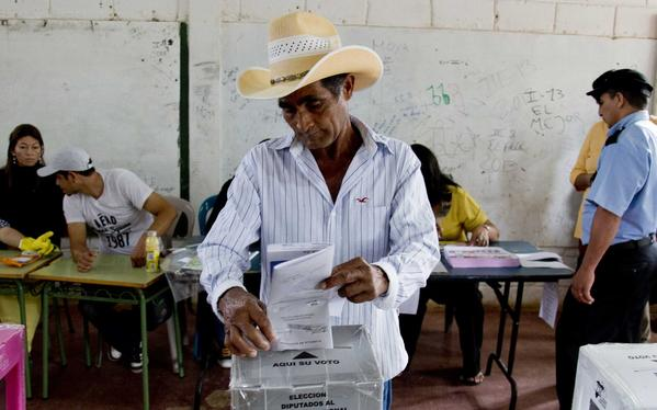 A man casts his ballot during general elections in Catacamas, Honduras, on Sunday. Hondurans are choosing a new president in a country reeling from violence, poverty and the legacy of a 2009 coup.