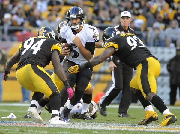 Ravens quarterback Joe Flacco is brought down by Steelers' Lawrence Timmons in the first meeting in October.