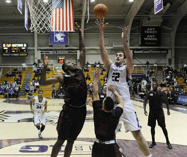 Northwestern center Alex Olah (22) goes to the hoop against Gardner-Webb.