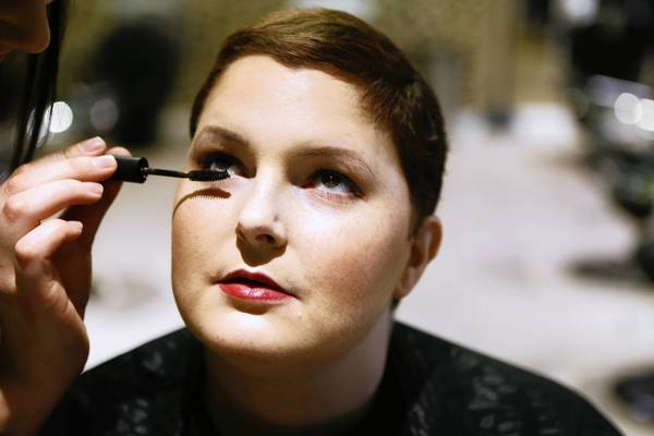 Meghan O'Brien, 31, has her makeup done professionally Sunday, one of the ways she tries to feel attractive while fighting lung cancer.