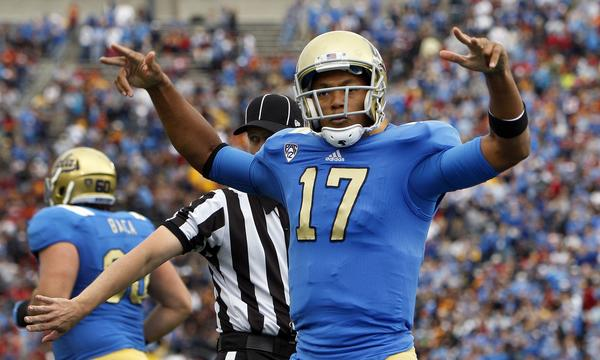 UCLA quarterback Brett Hundley celebrates after scoring a touchdown against USC last year. Hundley knows Bruins fans are expecting a win over the Trojans on Saturday.