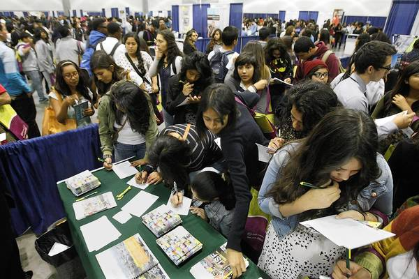 Colleges, particularly private ones that are not the top brand names, are working harder to court applicants, recruiting farther from their campuses and sweetening financial aid offers. Above, several thousand high school students crowd around recruiters at a college fair this month at the L.A. Convention Center.