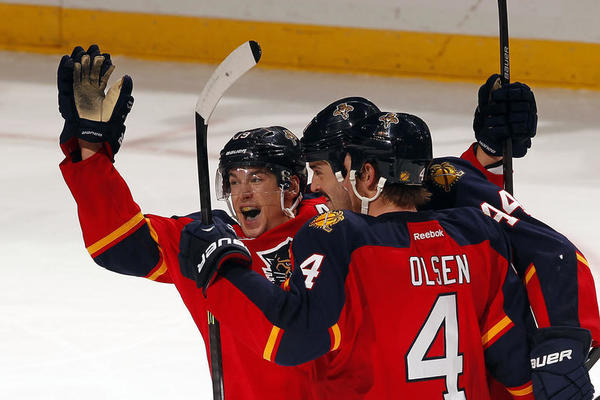 Erik Gudbranson #44 of the Florida Panthers is congratulated by teammates after scoring a goal against the Philadelphia Flyers at the BB&T Center on November 25, 2013 in Sunrise, Florida. (Getty)