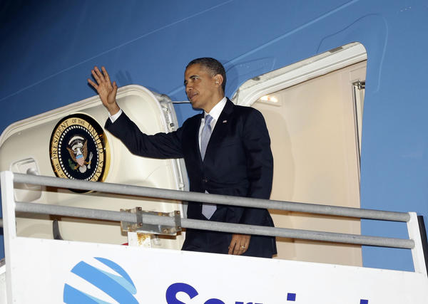 President Obama disembarks Monday from Air Force One at Los Angeles International Airport.