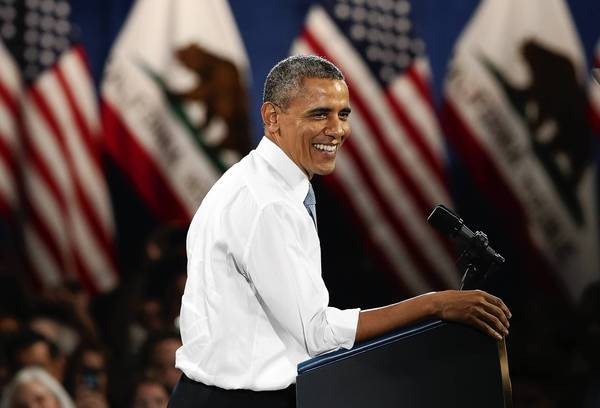 President Obama presses for an overhaul of immigration laws in a speech in San Francisco. He also is attending fundraisers in Los Angeles.