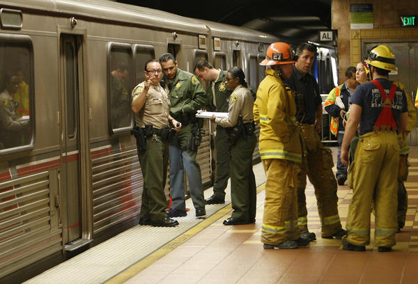 Los Angeles County sheriff's transit services bureau officers investigate the scene of a fatal accident involving a man killed by a Metro train on the Red Line at the Hollywood Boulevard and Vine Street station.
