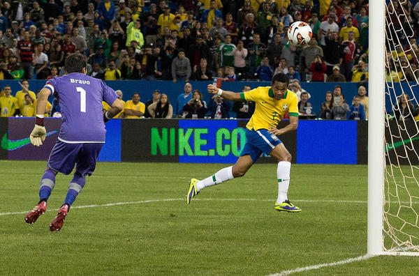 Brazil forward Robinho (7) attempts to head the ball towards the net on Chile goalkeeper Claudio Bravo (1) during the second half in a friendly soccer game at Rogers Centre in Toronto. Brazil won 2-1