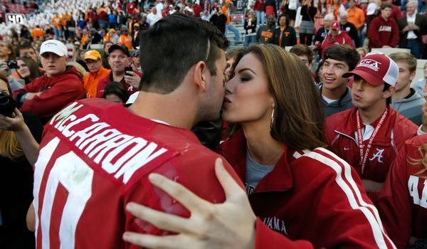 Katherine Webb kisses Alabama quarterback AJ McCarron after the Crimson Tide's win over Tennessee last month.