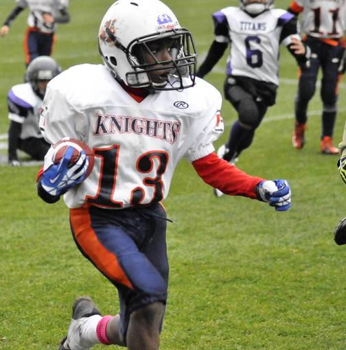 Orland Knights running back Henry Wilson breaks loose for a big gain in the Metro Youth Football League Super Bowl on Nov. 16 at Toyota Park.