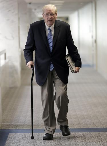 Sen. Jay Rockefeller, seen here arriving for a markup of the Senate Select Committee on Intelligence, has asked the FCC to hold off on approving any big television deals.
